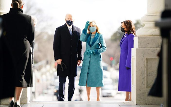 President-elect Joe Biden (L) and Jill Biden (C) with Vice President-elect Kamala Harris (R) arrive at the East Front of the US Capitol for his inauguration ceremony to be the 46th President of the United States in Washington, DC, on January 20, 2021 - GETTY IMAGES