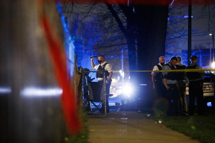 Chicago police work the scene of a shooting early Tuesday, April 6, 2021 in Chicago. Police say seven people were shot and wounded in a Chicago neighborhood overnight in the city's latest wave of gun violence. Chicago police say the seven were involved in a fight on the sidewalk when shots were fired late Monday in the Englewood neighborhood on Chicago's South Side. (Armando L. Sanchez/Chicago Tribune via AP)