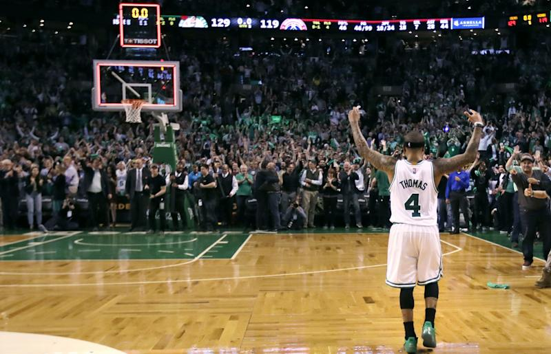 Isaiah Thomas soaks in the adulation after his brilliant game Tuesday night. (AP)
