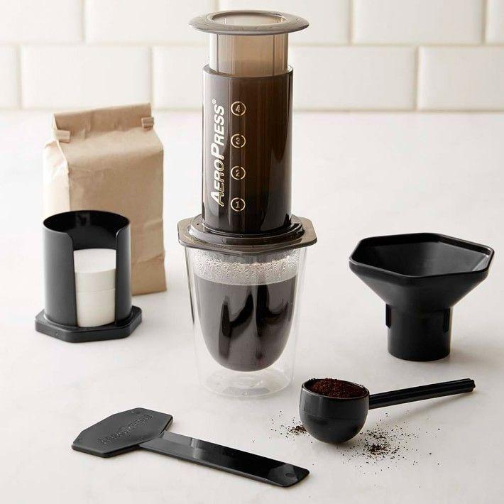 """<p><strong>AeroPress</strong></p><p>amazon.com</p><p><strong>$29.95</strong></p><p><a href=""""https://www.amazon.com/dp/B0047BIWSK?tag=syn-yahoo-20&ascsubtag=%5Bartid%7C10055.g.29250426%5Bsrc%7Cyahoo-us"""" rel=""""nofollow noopener"""" target=""""_blank"""" data-ylk=""""slk:Shop Now"""" class=""""link rapid-noclick-resp"""">Shop Now</a></p><p>Whether your coffee fanatic loves to camp and hike or simply likes to keep it light, and AeroPress is an excellent and compact way to brew anywhere.</p>"""