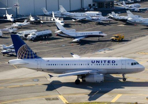 A United Airlines Airbus A319 airplane waits on a taxiway in California