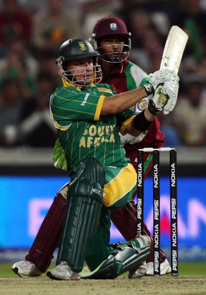 JOHANNESBURG, SOUTH AFRICA - SEPTEMBER 11: Denesh Ramdin of the West Indies watches as Herschelle Gibbs of South Africa hits out at The Wanderers Cricket Ground during The ICC World Twenty20 Championship on September 11, 2007 in Johannesburg, South Africa. (Photo by Julian Herbert/Getty Images)