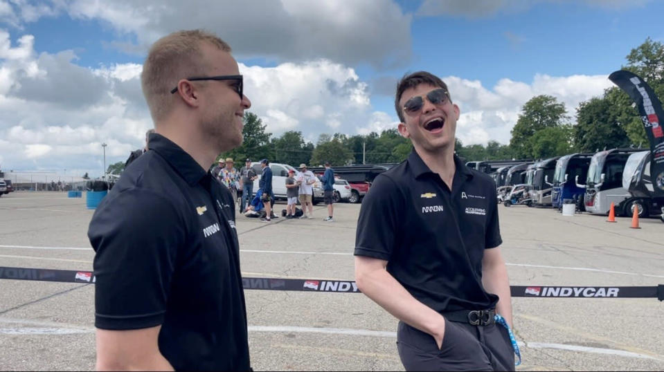 Felix Rosenqvist, left, talks with Arrow McLaren SP teammate Pato O'Ward, right, at Mid-Ohio Sports Car Course, Friday, July 2, 2021, in Lexington, Ohio. Rosenqvist missed two races after a crash last month at Detroit. He was in IndyCar's concussion protocol but will race Sunday on the road course. (AP Photo/Jenna Fryer)
