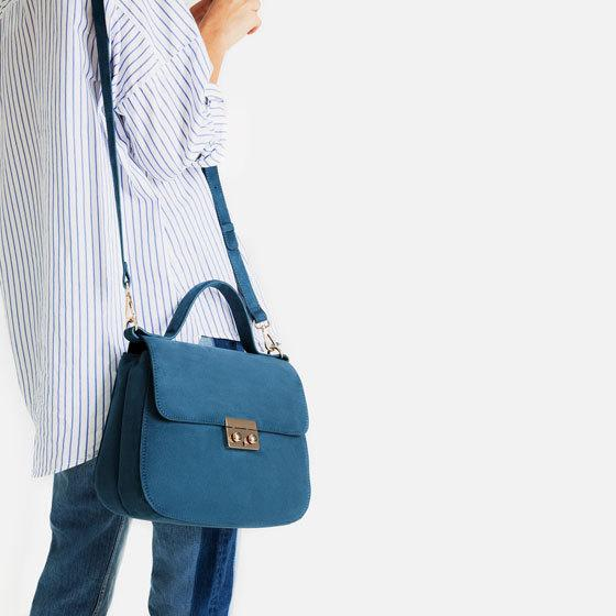"""<p><a href=""""http://www.zara.com/uk/en/woman/bags/hand-bags/city-bag-with-fastening-detail-c269201p3609577.html"""">£29.99 from ZARA</a></p>"""