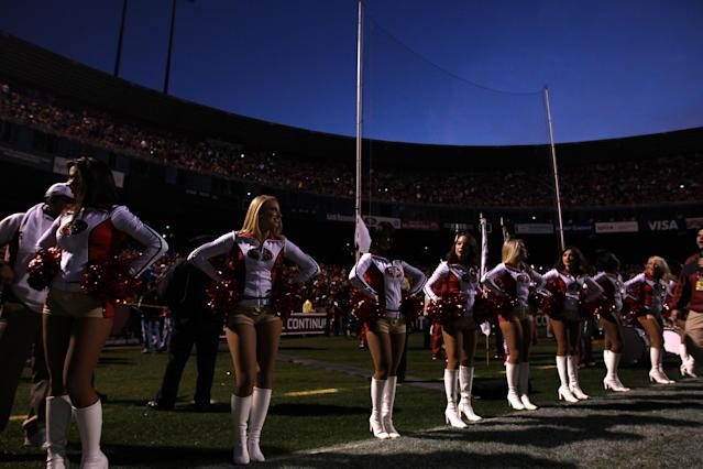 SAN FRANCISCO, CA - DECEMBER 19: San Francisco 49ers cheerleaders perform as the lights are out at Candlestick Park after a power outage delayed the start of the game against the Pittsburgh Steelers on December 19, 2011 in San Francisco, California. (Photo by Ezra Shaw/Getty Images)