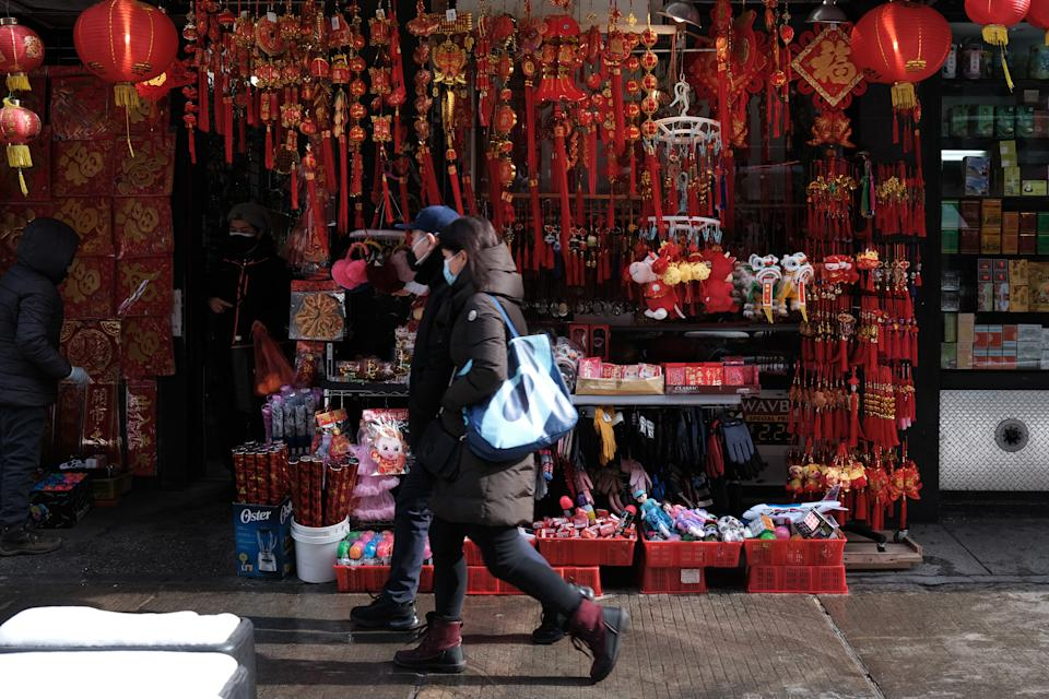NEW YORK, NEW YORK - FEBRUARY 11: Lunar New Year decorations are displayed in Chinatown on the eve of the holiday on February 11, 2021 in New York City. Lunar New Year, also known as the Chinese New Year or Spring Festival, begins on Friday and will conclude the Year of the Rat and begin the Year of the Ox. While the annual Chinese celebration is usually a time for gatherings with family and friends, this year's events will be limited due to the Covid-19 pandemic. (Photo by Spencer Platt/Getty Images)