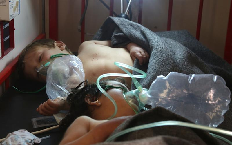 Syrian children receive treatment following a suspected toxic gas attack in Khan Sheikhun, a rebel-held town in the northwestern Syrian Idlib province, on April 4, 2017. - AFP