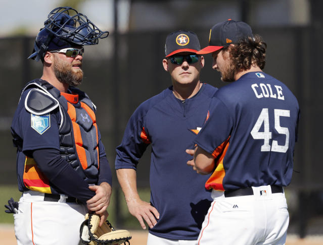 Houston Astros pitcher Gerrit Cole (45) talks with manager A.J. Hinch and catcher Brian McCann, left, after throwing a bullpen session during spring training baseball practice Thursday, Feb. 15, 2018, in West Palm Beach, Fla. (AP Photo/Jeff Roberson)