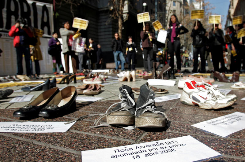"In this Thursday, July 30, 2009 file photo Shoes representing female victims of violence are displayed by protesters from the Chilean Network Against Domestic and Sexual Violence in Santiago. The sign at bottom reads in Spanish ""Rosa Alvarado, 31, stabbed by ex-boyfriend, 16 April 2008."" About a third of women worldwide have been physically or sexually assaulted by a former or current partner, according to the first major review of violence against women. In a series of papers released on Thursday June 20, 2013 by the World Health Organization and others, experts estimated nearly 40 percent of women killed worldwide were slain by an intimate partner and that being assaulted by a partner was the most common kind of violence experienced by women. (AP Photo/Santiago Llanquin, File)"