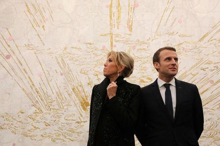 French President Emmanuel Macron (R) and his wife Brigitte Macron (L) visit the Ullens Chinese Contemporary Art Centre in Beijing