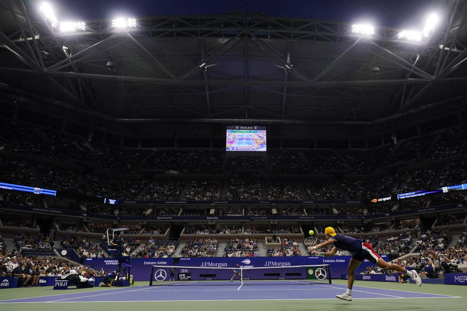 Holger Vitus Nodskov Rune of Denmark, reaches for a ball from Novak Djokovic, of Serbia, during the first round of the US Open tennis championships, Tuesday, Aug. 31, 2021, in New York. (AP Photo/Frank Franklin II)