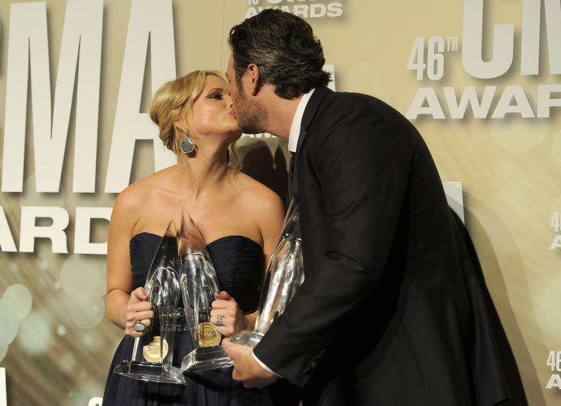 """Miranda Lambert, winner of the awards for song of the year for """"Over You"""" and female vocalist of the year, left, and Blake Shelton, winner of the awards for male vocalist of the year, song of the year for """"Over You"""" and entertainer of the year, pose backstage at the 46th Annual Country Music Awards at the Bridgestone Arena on Thursday, Nov. 1, 2012, in Nashville, Tenn. (Photo by Chris Pizzello/Invision/AP)"""