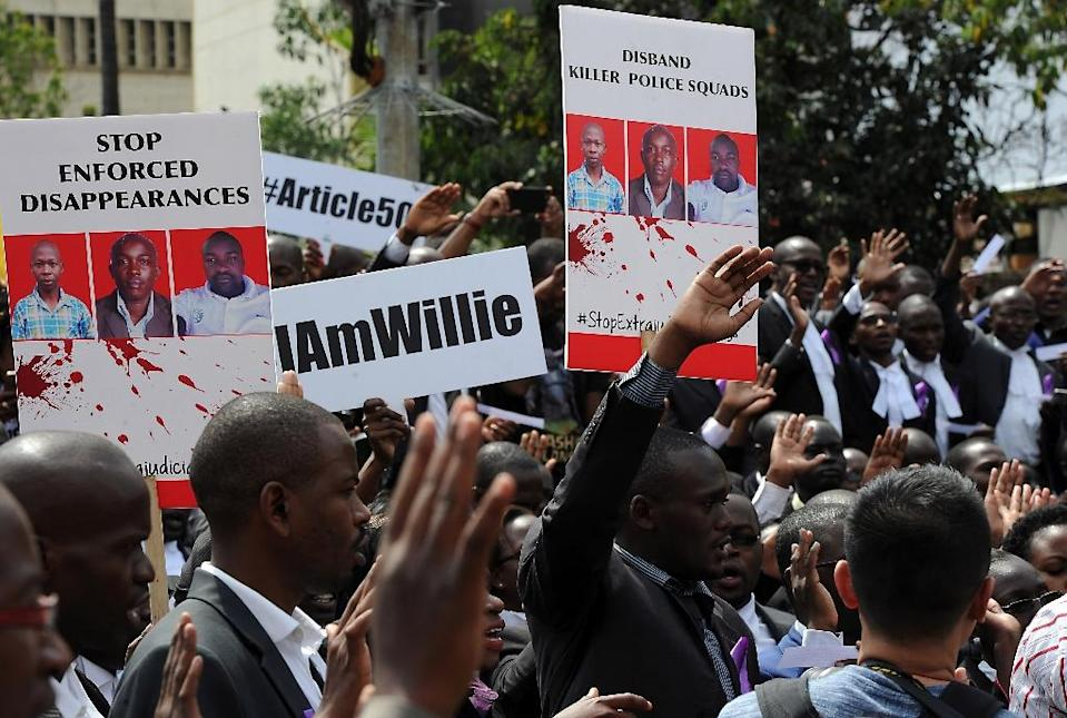 Kenyan lawyers march in Nairobi on July 6, 2016 to protest against the murder of three men, including lawyer Willie Kimani, by police officers (AFP Photo/Tony Karumba)