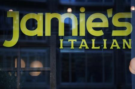 Signage for restaurant chain Jamie's Italian is seen in London
