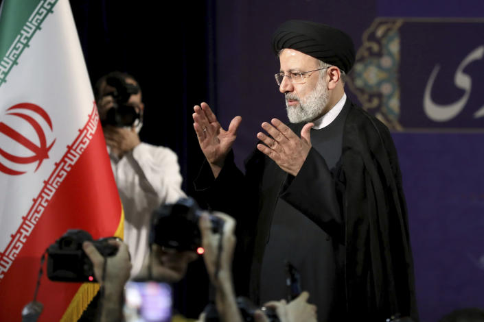 Ebrahim Raisi, head of Iran's judiciary leaves a news conference after registering his candidacy for the June 18 presidential elections at the elections headquarters of the Interior Ministry in Tehran, Iran, Saturday, May 15, 2021. (AP Photo/Ebrahim Noroozi)