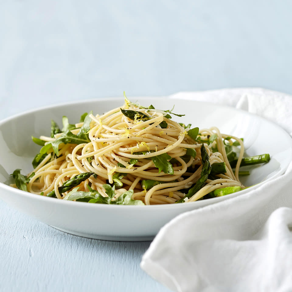 "<p>""Cacio e pepe"" means ""cheese and pepper"" in Italian. This spaghetti dish, with fresh asparagus and baby arugula, is flavored with ""cacio e pepe"" and a little lemon zest. It's simple to prepare and on the table in just 25 minutes. <a href=""http://www.eatingwell.com/recipe/266595/springtime-cacio-e-pepe/"" rel=""nofollow noopener"" target=""_blank"" data-ylk=""slk:View recipe"" class=""link rapid-noclick-resp""> View recipe </a></p>"