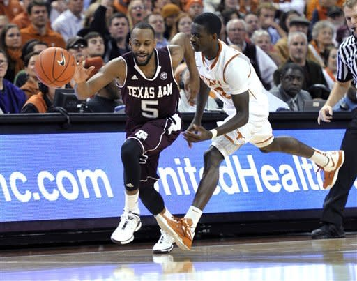 Texas A&M guard Dash Harris, left, steals the ball from Texas guard Myck Kabongo during the first half of an NCAA college basketball game Wednesday, Jan. 11, 2012, in Austin, Texas. (AP Photo/Michael Thomas)
