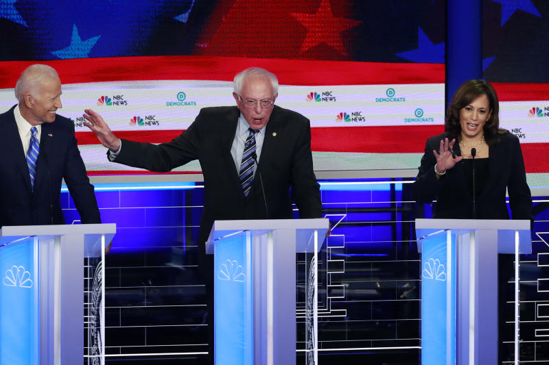 Democratic presidential candidate Sen. Bernie Sanders, I-Vt., , center, gestures towards former vice president Joe Biden, as Sen. Kamala Harris, D-Calif., talks, during the Democratic primary debate hosted by NBC News at the Adrienne Arsht Center for the Performing Art, Thursday, June 27, 2019, in Miami. (AP Photo/Wilfredo Lee)