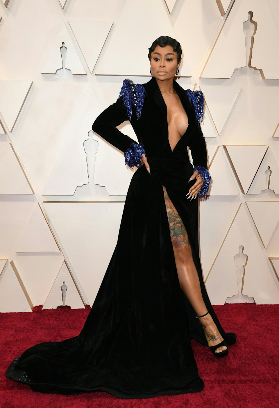 The model and designer wasn't afraid to show some skin in a plunging black gown with blue accents.