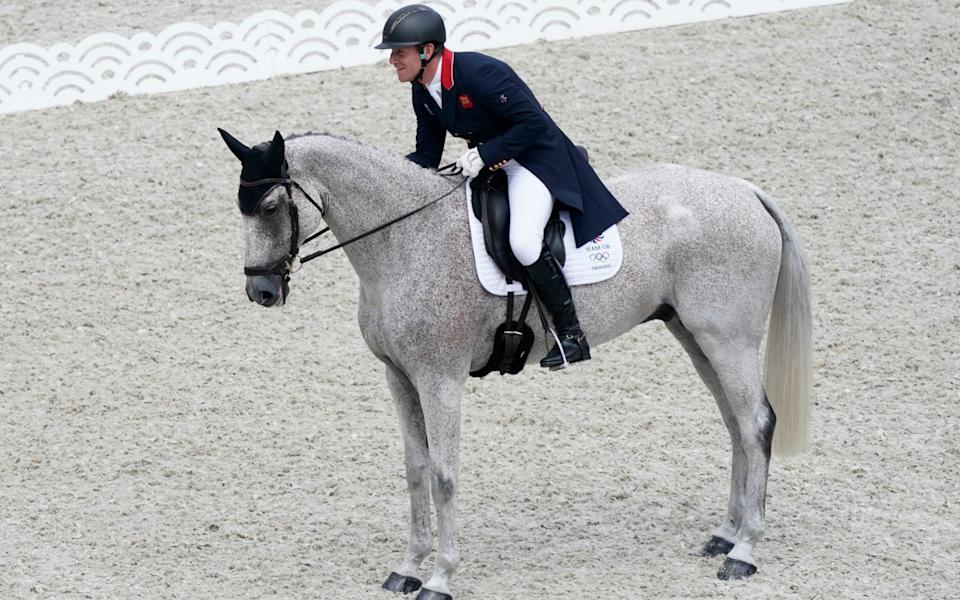 Britain's Oliver Townend, riding Ballaghmor Class, reacts after competing during the Equestrian Eventing Dressage competition at Equestrian Park during the 2020 Summer Olympics, Friday, July 30, 2021, in Tokyo, Japan. - AP Photo/Carolyn Kaster