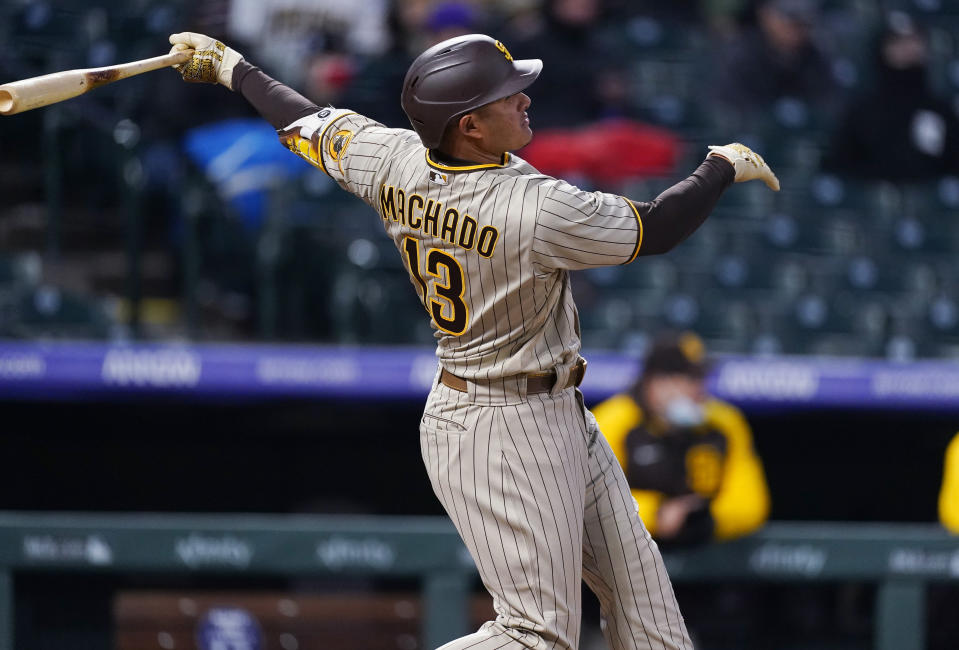 San Diego Padres' Manny Machado watches his two-run home run against the Colorado Rockies during the fifth inning of a baseball game Tuesday, May 11, 2021, in Denver. (AP Photo/David Zalubowski)