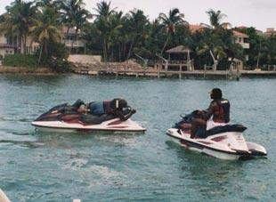 Nevin Shapiro and a second source said this photo of D.J. Williams (left) and Leon Williams (right) was taken during a yacht outing in the summer of 2003. The two players are on the booster's personal watercraft.