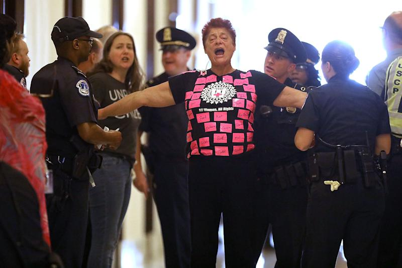 Demonstrators are arrested by U.S. Capitol police while protesting against Republican health care reform legislation outside the offices of Sen. Cory Gardner (R-Colo.) in the Russell Senate Office Building on Capitol Hill.
