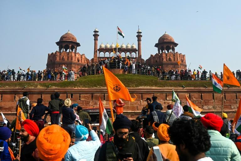 At the historic Red Fort landmark farmers broke through police lines and put up their own emblem on the flagpole