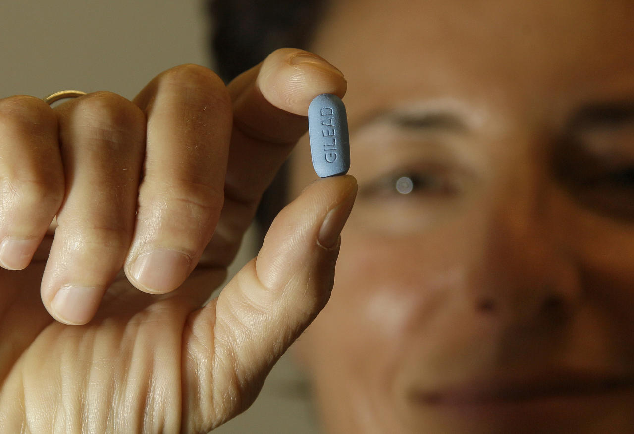 In this Thursday, May 10, 2012 photo, Dr. Lisa Sterman holds up a Truvada pill at her office in San Francisco. Sterman prescribes the drug off-label for about a dozen patients at high risk for developing AIDS. The pill, already used to treat people with HIV, also helps prevent the virus from infecting healthy people. The Food and Drug Administration is expected to decide by June 15 whether the pill's maker Gilead Sciences should be allowed to formally market the drug for preventive use. (AP Photo/Jeff Chiu)