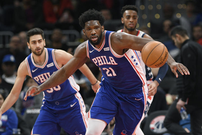Philadelphia 76ers center Joel Embiid (21) chases the ball during the first half of the team's NBA basketball game against the Washington Wizards, Thursday, Dec. 5, 2019, in Washington. (AP Photo/Nick Wass)