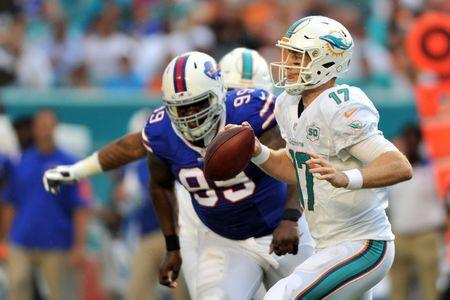 Sep 27, 2015; Miami Gardens, FL, USA; Miami Dolphins quarterback Ryan Tannehill (17) is pressured by Buffalo Bills defensive tackle Marcell Dareus (99) during the first half at Sun Life Stadium. Mandatory Credit: Steve Mitchell-USA TODAY Sports / Reuters Picture Supplied by Action Images