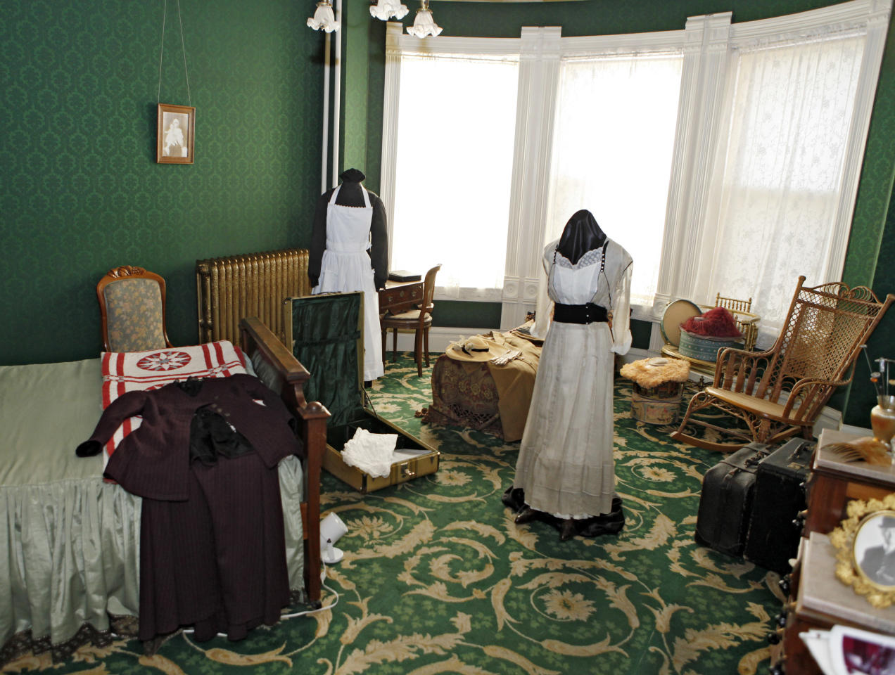 """This March 19, 2012 photo shows Molly's bedroom in the Molly Brown House Museum in Denver. A few blocks from Colorado's state Capitol _ over 1700 miles from the Atlantic Ocean and a mile above sea level _ is a museum dedicated to a woman eclipsed by legend following the sinking of the Titantic. The """"unsinkable Molly Brown"""" moved into this stone Victorian home after she and her husband struck it rich at a gold mine in Colorado's mountains, nearly 20 years before she boarded the Titanic because it was the first boat she could get back home to visit her ailing grandson. (AP Photo/Ed Andrieski)"""