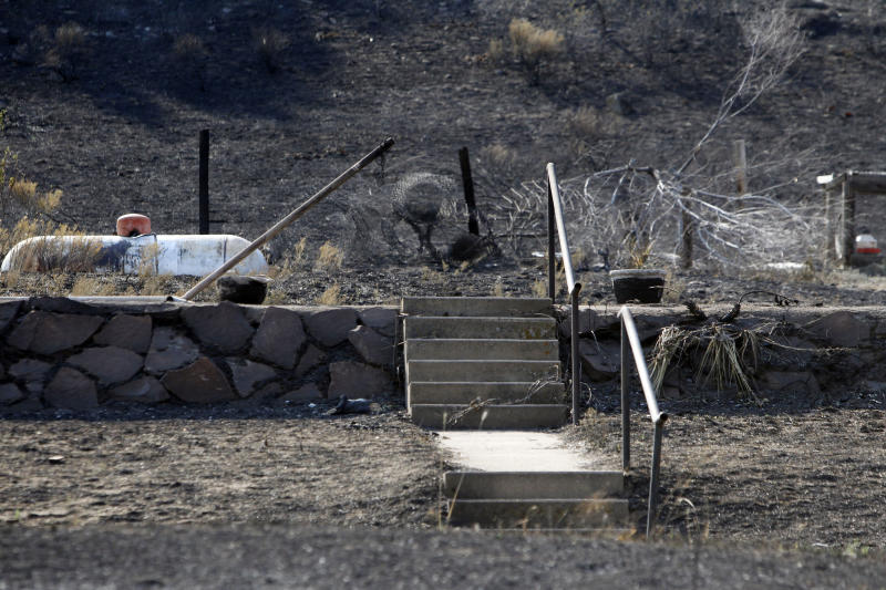 The stairs that led to a home that was destroyed by the High Park Wild fire are photographed during a tour by fire officials in Poudre Canyon west of Fort Collins, Colo., on Wednesday, June 20, 2012. The largest Colorado blaze west of Fort Collins was 55 percent contained and has destroyed at least 189 homes since it was sparked by lightning June 9. (AP Photo/Ed Andrieski)