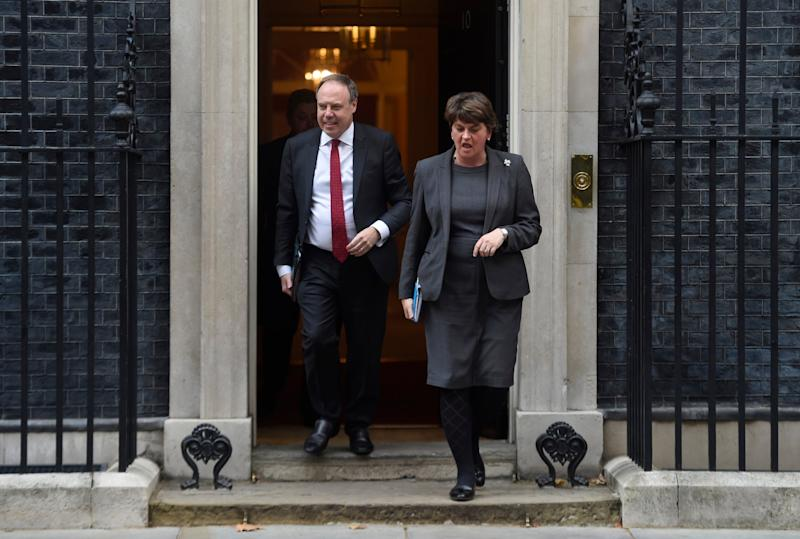 Arlene Foster, leader of the DUP and Nigel Dodds leave Downing Street following talks with UK Prime Minister. (Getty Images)