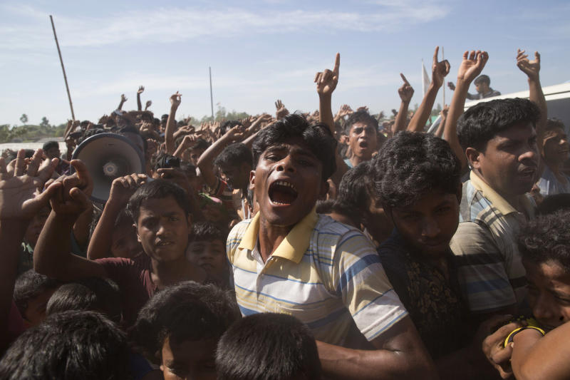 FILE - In this file photo dated Thursday, Nov. 15, 2018, Rohingya refugees shout slogans during a protest against the repatriation process at Unchiprang refugee camp near Cox's Bazar, in Bangladesh.  Sexual violence carried out by Myanmar's security forces against the country's Muslim Rohingya minority was so widespread and severe that it demonstrates intent to commit genocide as well as warrants prosecution for war crimes and crimes against humanity, according to a U.N. report released Thursday Aug. 22, 2019. The Rohingya refugees still live in squalid camps in Bangladesh, and a planned effort Thursday to repatriate an initial large group to Myanmar collapsed when none showed up to be taken back. (AP Photo/Dar Yasin, FILE)