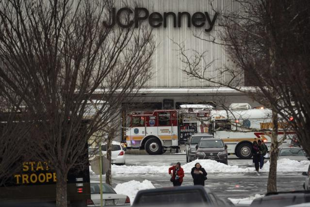 Civilians walk from a building after a shooting at a shopping mall in Columbia, Maryland January 25, 2014. Three people died in a shooting at a large shopping mall outside of Baltimore, Maryland, on Saturday, and one of the dead was believed to be the shooter, police said. REUTERS/James Lawler Duggan (UNITED STATES - Tags: CRIME LAW)