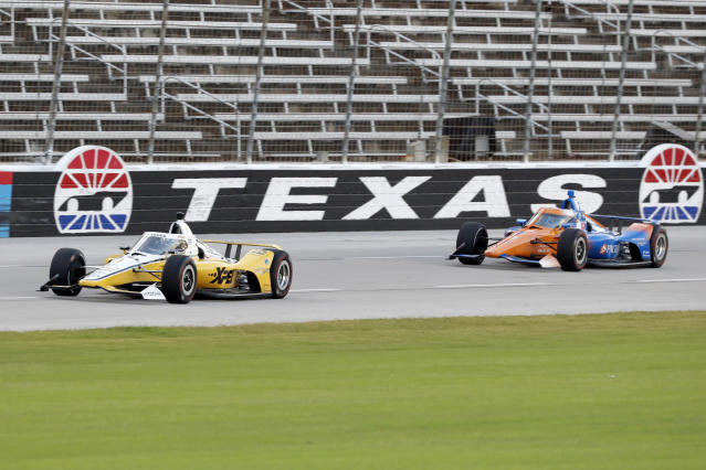 Josef Newgarden, left, leads Scott Dixon down the front stretch during an IndyCar auto race at Texas Motor Speedway in Fort Worth, Texas, Saturday, June 6, 2020. (AP Photo/Tony Gutierrez)