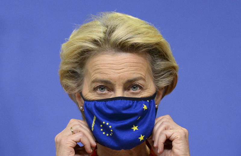 European Commission President Ursula von der Leyen adjusts her facemask ahead of delivering a statement ahead of the first day of a European Union (EU) summit at The European Council Building in Brussels on October 1, 2020. (Photo by JOHANNA GERON / POOL / AFP) (Photo by JOHANNA GERON/POOL/AFP via Getty Images)