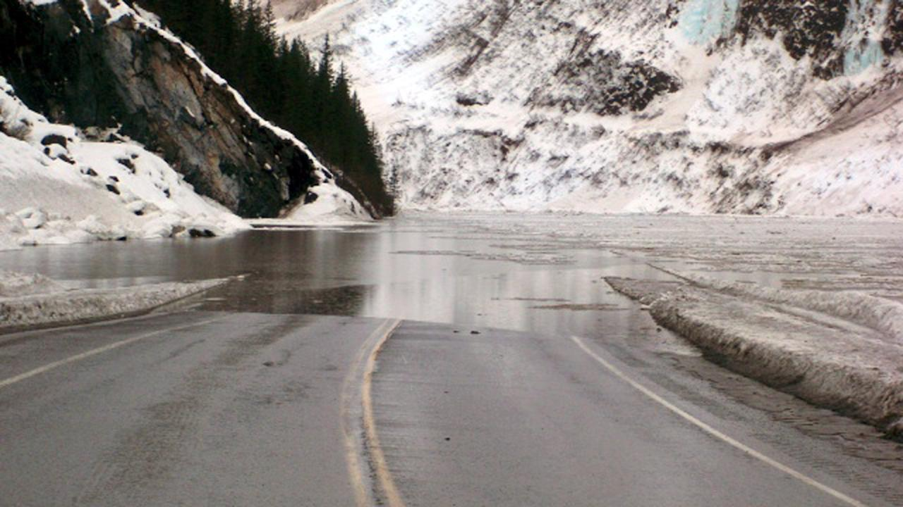 This Jan. 24, 201 4 photo provided by the Alaska Department of Transportation & Public Facilities shows multiple avalanches that crossed the Richardson Highway in the Thompson Pass region of Valdez, Alaska, causing flooding. Alaska highway officials say the only highway into the city of 4,100 people will be closed until further notice, for at least a week, if not much longer. (AP Photo/Alaska Department of Transportation & Public Facilities)