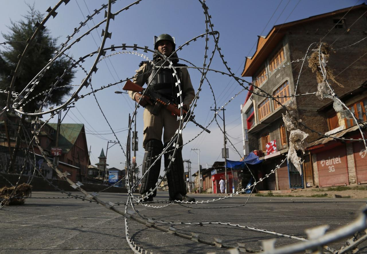 <p>An Indian paramilitary soldier stands guard at a temporary check point during restrictions in Srinagar, Indian controlled Kashmir, Tuesday, July 25, 2017. Kashmiri separatists have called for a strike on Tuesday to protest against the arrest of seven separatist leaders by India's National Investigation Agency on charges of receiving funds from Pakistan-based militant groups. (AP Photo/Mukhtar Khan) </p>