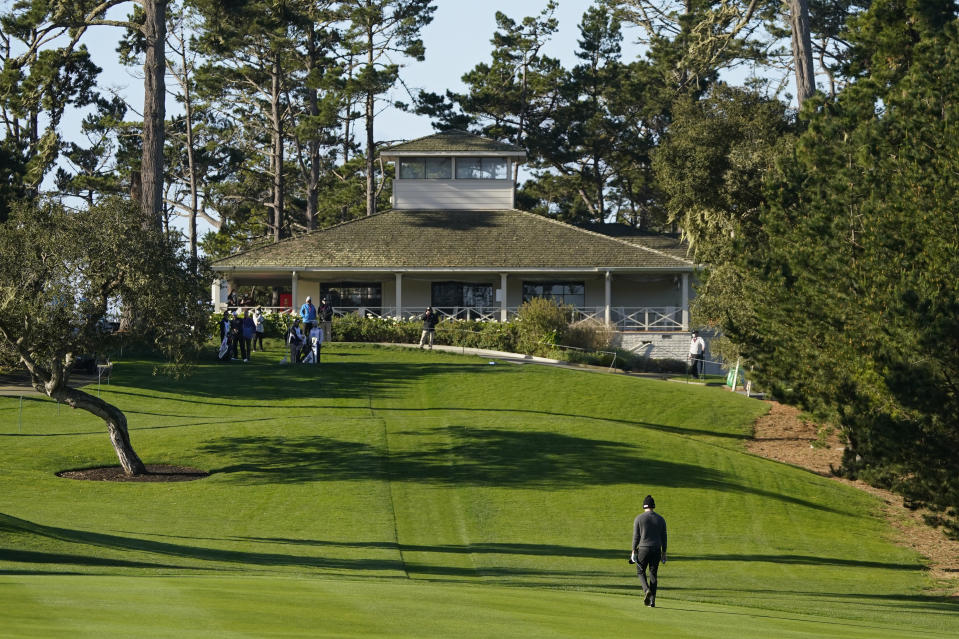 Patrick Cantlay walks back to the 10th tee of the Spyglass Hill Golf Course to hit again after a lost ball during the second round of the AT&T Pebble Beach Pro-Am golf tournament Friday, Feb. 12, 2021, in Pebble Beach, Calif. (AP Photo/Eric Risberg)