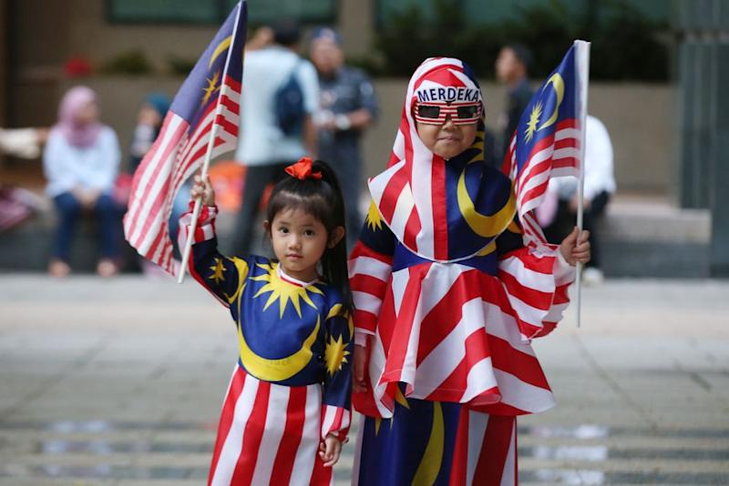 Children clad in the 'Jalur Gemilang' are pictured at Dataran Putrajaya August 31, 2018. — Picture by Azneal Ishak