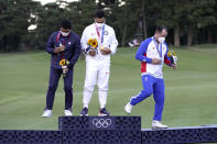 Xander Schauffele, of the United States, holds his gold medal next to bronze medal winner C.T. Pan of Taiwan, left, and silver medal winner Rory Sabbatini, of Slovakia, right, for the men's golf at the 2020 Summer Olympics on Sunday, Aug. 1, 2021, in Kawagoe, Japan. (AP Photo/Andy Wong)