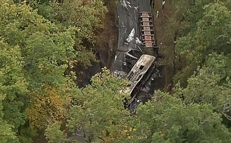 TOPSHOTS This video grab taken from footage obtained from French TV news channel BFM TV shows the wreckage of a coach carrying elderly day-trippers that collided with a lorry, killing at least 43 people on October 23, 2015 (AFP Photo/-)