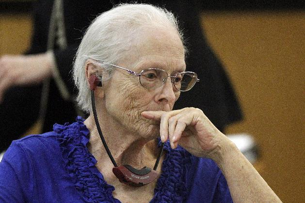 Alice Uden listens to the judge during jury selection at the Laramie County District Court on Tuesday, April 29, 2014. Uden faces one count of first-degree murder for allegedly killing her husband nearly 40 years ago. (AP Photo/The Wyoming Tribune Eagle, Miranda Grubbs)