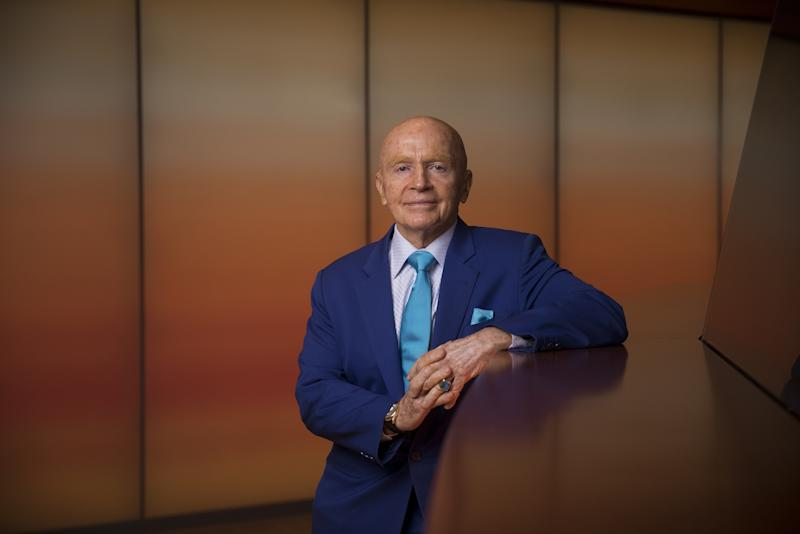 """(Bloomberg) -- Veteran investor Mark Mobius says that gold's set to push higher, potentially topping $1,500 an ounce, as interest rates head lower, central banks extend purchases, and uncertainty surrounding geopolitics and cryptocurrencies fans demand.""""I love gold,"""" Mobius, who set up Mobius Capital Partners LLP last year after three decades at Franklin Templeton Investments, said in an interview in Singapore, adding bullion should always form part of a portfolio, with a holding of at least 10%. """"As these interest rates come down, where do you go?""""Gold has rallied in 2019, rising to the highest level in six years, as investors contemplate slowing economic growth, prospects for easier monetary policy in the U.S. and Europe and festering trade frictions. The upswing has been given added momentum as central banks, including authorities in Russia and China, step up purchases. A revival in cryptocurrencies may lead to spillover demand from investors for the older haven, according to Mobius.""""Interest rates are going so low, particularly now in Europe,"""" he said. """"What's the sense of holding euro when you get a negative rate? You might as well put it into gold, because gold is a much better currency.""""Spot gold -- which hit $1,439.21 an ounce on June 25, the highest since 2013 -- traded at $1,413.50 on Thursday. It's up 10% this year after the Federal Reserve signaled a willingness to cut rates and other central banks considered fresh stimulus. It last topped $1,500 in April 2013.Mobius isn't the only high-profile gold fan as prices climb. Billionaire trader Paul Tudor Jones has listed the metal as his favorite pick over the next 12-to-24 months, saying that prices could move to $1,700 once they breach $1,400. BlackRock Inc. said last month it expects bullion to end the year higher.(Updates with outlooks from Tudor Jones, BlackRock in final paragraph.)To contact the reporter on this story: Ranjeetha Pakiam in Singapore at rpakiam@bloomberg.netTo contact the editors responsi"""
