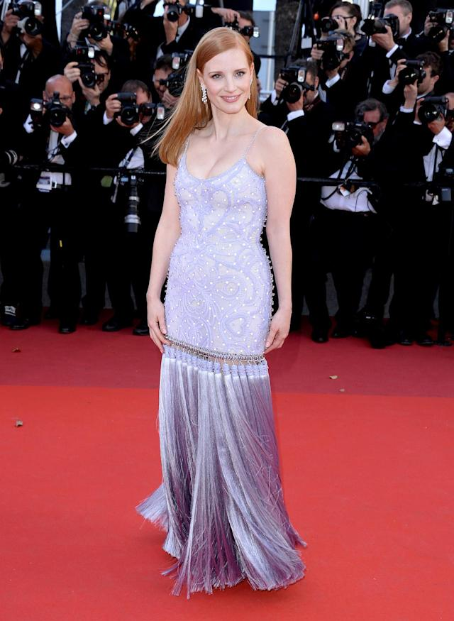 <p>The exaggerated tassel train of Jessica Chastain's Givenchy dress was the highlight of her pretty look. (Photo: Anthony Harvey/FilmMagic) </p>