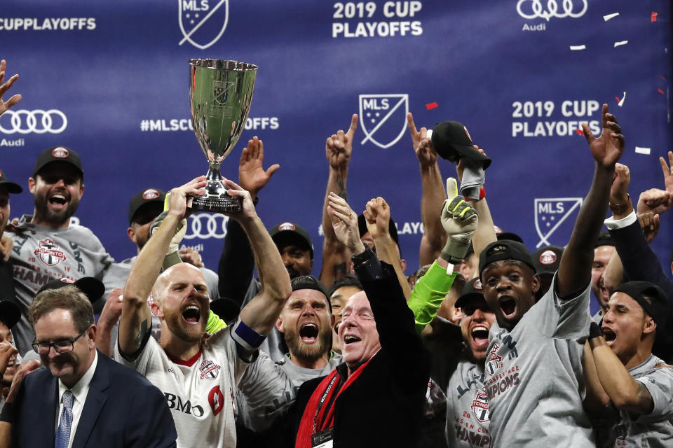 A first-half goal from Nicolas Benezet and and late stunner from Nick DeLeon lifted Toronto FC to its third Eastern Conference title in four years. (AP)