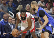 Houston Rockets' James Harden, left, looks for a way past Orlando Magic's Evan Fournier during the first half of an NBA basketball game, Friday, Dec. 13, 2019, in Orlando, Fla. (AP Photo/John Raoux)