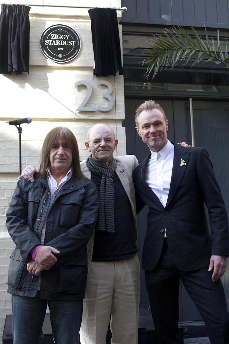 """Trevor Bolder, left and Mick Woodmansey, center,  members of the Spiders from Mars and Spandau Ballet band member Gary Kemp unveil a commemorative plaque to David Bowie's iconic creation, Ziggy Stardust, in Heddon Street, London, Tuesday March 27, 2012 to mark the 40th anniversary of the album """"The Rise and Fall of Ziggy Stardust and The Spiders from Mars.""""  The album cover was shot in Hedden Street. (AP Photo/ David Parry/PA)  UNITED KINGDOM OUT"""